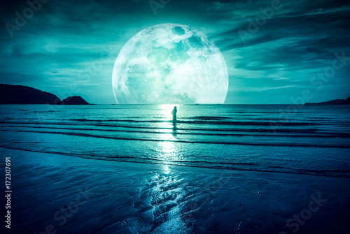 Fotobehang Groen blauw Super moon. Colorful sky with cloud and bright full moon over seascape.
