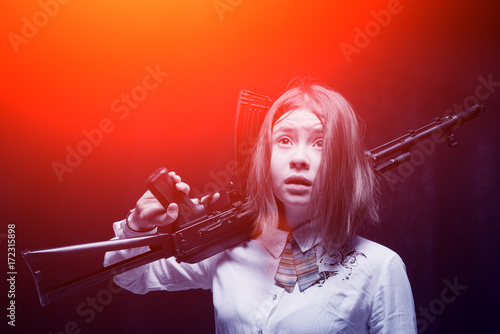 Poster Girl with a frightened look with a Kalashnikov in his hand