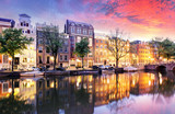 Sunset city view of Amsterdam, the Netherlands with Amstel river