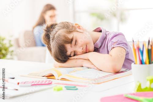 Lazy girl sleeping on her books