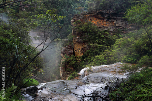 Flowing over the ledge at Wentworth Falls Poster