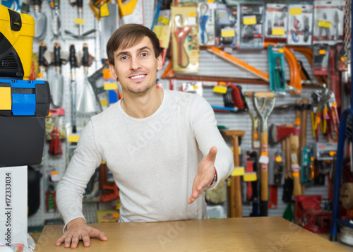 Plakat Male seller posing at tooling section