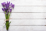 Fresh flowers of lavender bouquet, top view on white wooden background - 172339633