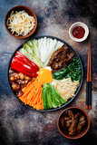 Bibimbap, traditional Korean dish, rice with vegetables and beef. Top view, overhead, flat lay - 172340616