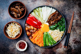 Bibimbap, traditional Korean dish, rice with vegetables and beef. Top view, overhead, flat lay - 172340651
