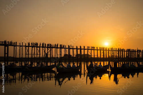 Fridge magnet Silhouettes of tourists in boats admiring U Bein bridge over the Taungthaman Lake at sunset, in Amarapura, Mandalay, Myanmar