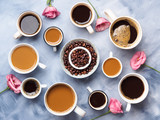 Cups and mugs of coffee and flowers on blue background