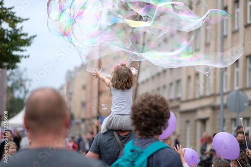 Sticker A holiday of soap bubbles in a city street. Riga, Latvia