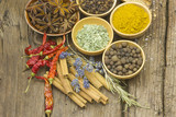 Variety of spices on wooden background - 172374017