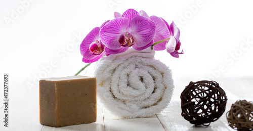 Foto op Plexiglas Spa olive oil soap, rolled towel and orchids for healthy purity