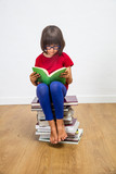beautiful young schoolgirl with eyeglasses reading for culture power, indoor - 172377842