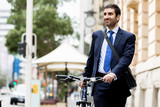 Young businessmen with a bike - 172378226
