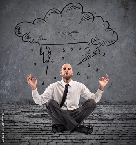 Fototapeta Businessman practice yoga under a rainy cloud