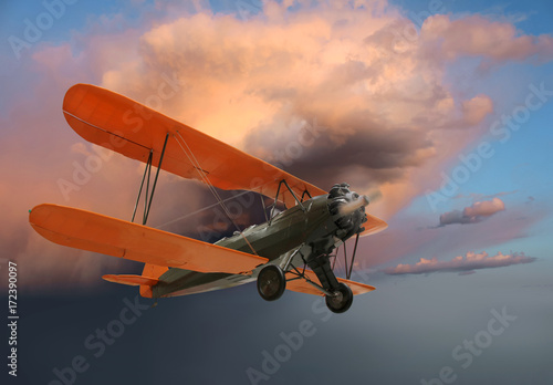 Old biplane in flight Poster