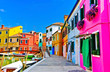Quadro View of the colorful Venetian houses along the canal at the Islands of Burano in Venice.