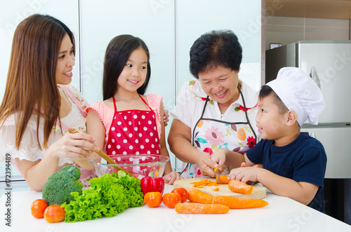 Kitchen lifestyle of asian family Poster