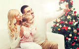 family taking selfie with smartphone at christmas - 172414062