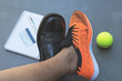 Quadro Life balance concept for work and exercise in top view half of business and sport shoes.