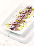 Salted herring fillet with leek and onion