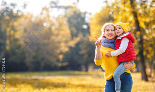 happy family mother and child daughter on   autumn walk - 172445283