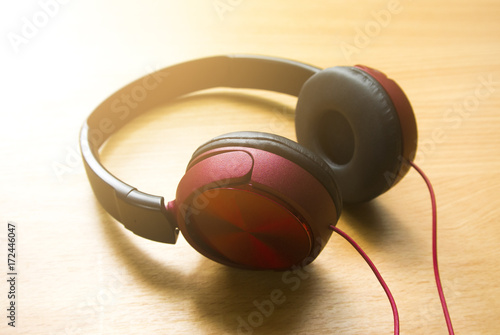 Poster red music headphone on wood table ground