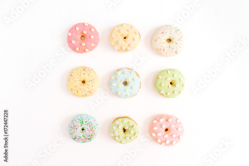 Colorful donuts on white background Poster