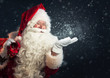 Santa Claus blowing magic snow of his hands