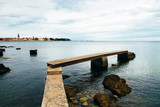 Old wooden Bridge In The Sea