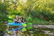 Family kayaking, mother and child paddling in kayak on river canoe tour, active summer weekend and vacation, sport and fitness concept