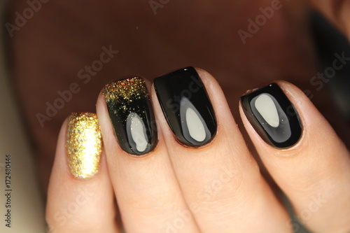 Fotobehang Manicure manicure design black and gold