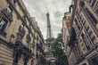 View of the Eiffel Tower from a tiny street, Paris, France