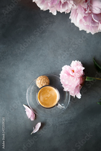 Cup of espresso set with peonies, overview with copyspace Poster