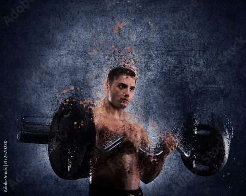 Wall mural Athletic man training biceps