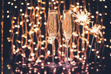 glasses of champagne and sparklers - 172590688