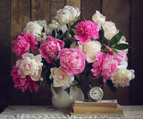 Bouquet of peonies in a white pitcher. - 172594010