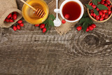 tea with rose hips and honey on old wooden background with copy space for your text. Top view - 172607846