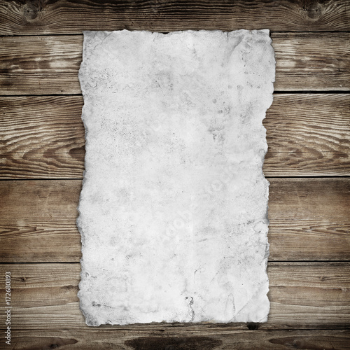 Old paper on the wood background - 172680893