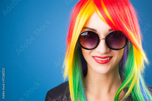 beautiful woman wearing color wig and sunglasses