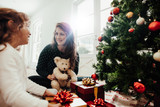 Family celebrating Christmas with lots of gifts. - 172685421