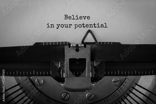 Text Believe in your potential typed on retro typewriter Poster