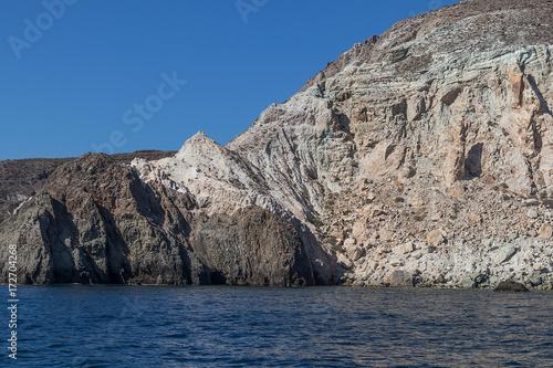 Fotobehang Santorini cliff by the sea