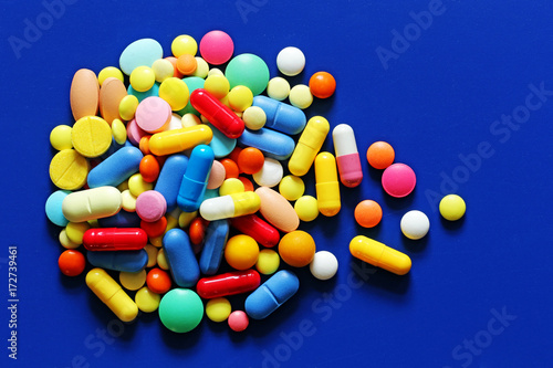Tuinposter Apotheek Colorful pills on a blue background