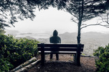 Man sitting on bench overlooking sea on Vancouver Island - 172751251