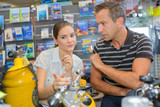 man and woman chooses diving gear - 172751495
