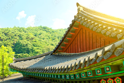 Sun flare seen at the rooftop of certain buddhist monastery located near Seoul - Poster