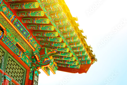 Sun flare above rooftop of an old buddhist monastery located near Seoul - South Poster