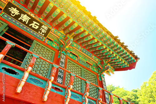 Sun flare over rooftop of some buddhist monastery located near Seoul - South Kor Poster