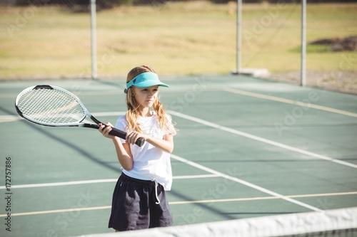 Fotobehang Tennis Girl playing tennis on sunny day
