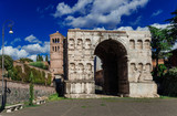Arch of Janus in Rome with old medieval bell tower - 172774682