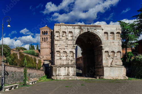 Foto op Aluminium Rome Arch of Janus in Rome with old medieval bell tower